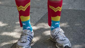 A man wears wonder woman socks during the Equality March for Unity & Pride parade in Washington DC, June 11, 2017. / AFP PHOTO / Andrew CABALLERO-REYNOLDS        (Photo credit should read ANDREW CABALLERO-REYNOLDS/AFP/Getty Images)