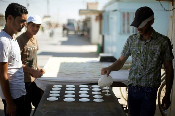 A Syrian refugee man makes traditional sweets during the Muslim fasting month of Ramadan at the Al-Zaatari camp June 1.