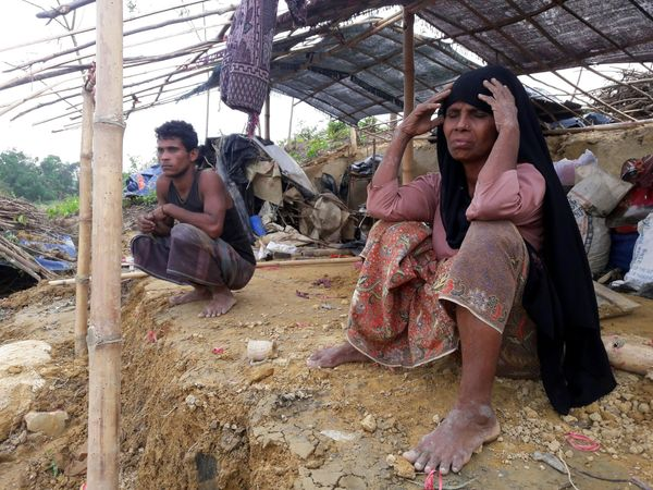 A Rohingya refugee sits near a house destroyed by Cyclone Mora in a camp in the Cox's Bazar district on May 31. Aid workers w