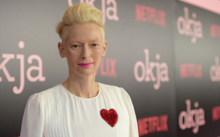"Tilda Swinton spoke to reporters about George Clooney at the New York premier of ""Okja"" on June 8."