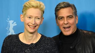 US actor George Clooney (R) and British actress Tilda Swinton pose during a photo call for the film 'Hail, Caesar!' screened as opening film of the 66th Berlinale Film Festival in Berlin on February 11, 2016.  The 66th Berlin film festival starts on February 11, 2016 with a spotlight on Europe's refugee crisis.  / AFP / TOBIAS SCHWARZ        (Photo credit should read TOBIAS SCHWARZ/AFP/Getty Images)