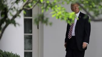 U.S. President Donald Trump leaves after attending an event welcoming the Clemson Tigers, the 2016 NCAA Football National Champions, at the White House in Washington, U.S. June 12, 2017. REUTERS/Carlos Barria