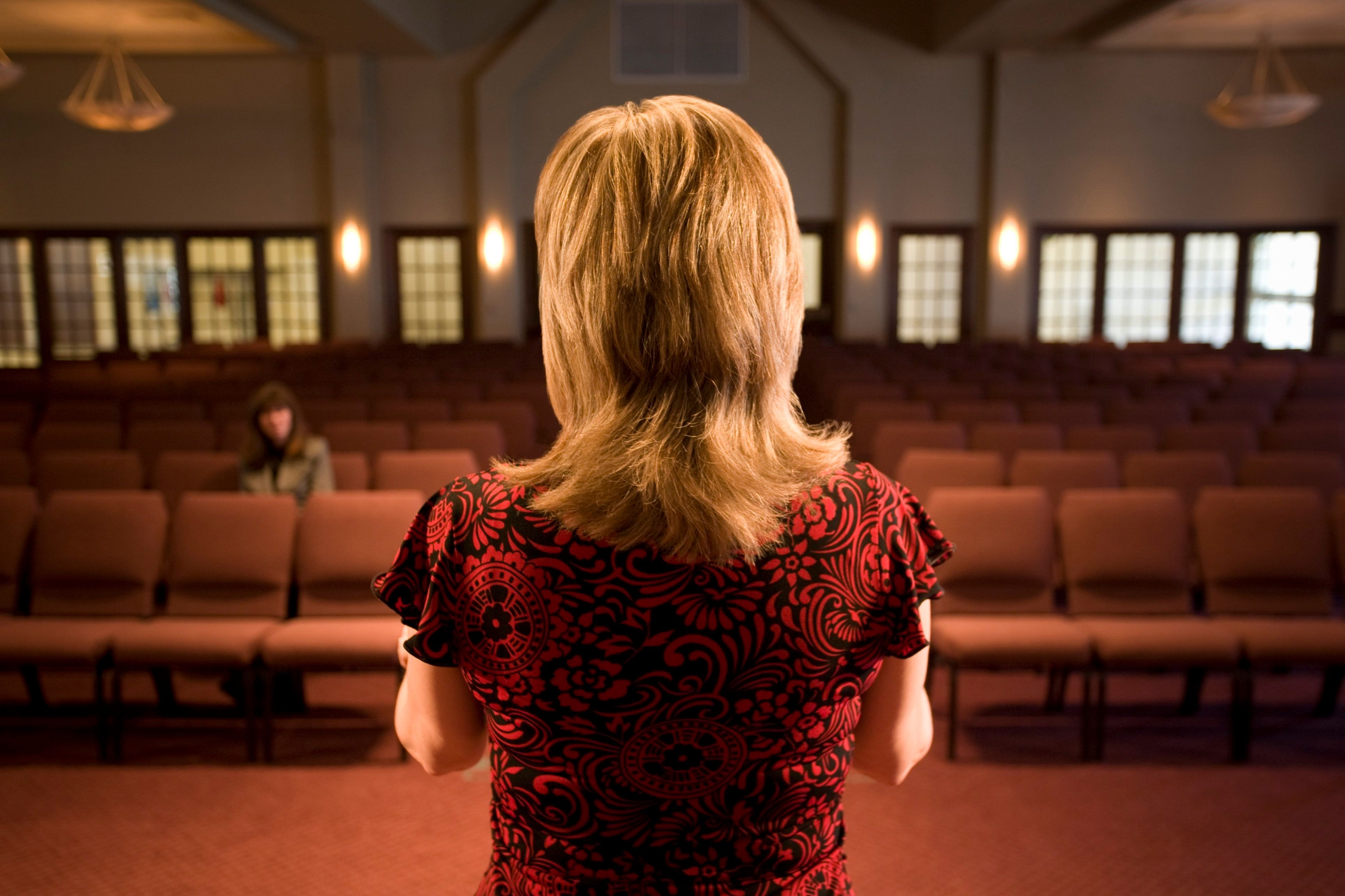 Woman at the front of an empty room