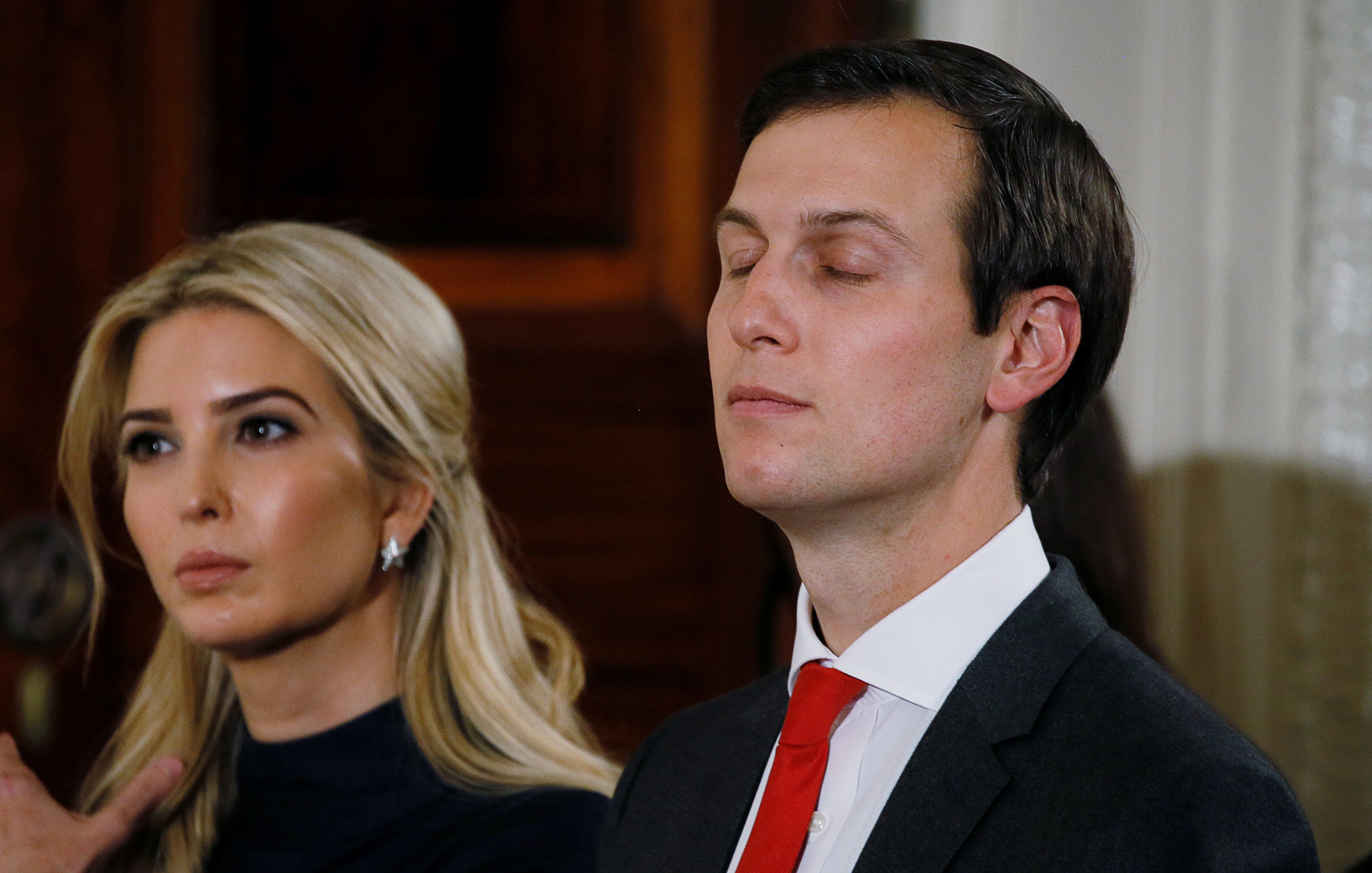 FILE PHOTO: White House Senior Advisor Jared Kushner sits with his wife Ivanka Trump (L) at President Donald Trump's joint news conference with German Chancellor Angela Merkel in the East Room of the White House in Washington, U.S. March 17, 2017. REUTERS/Jim Bourg/Files