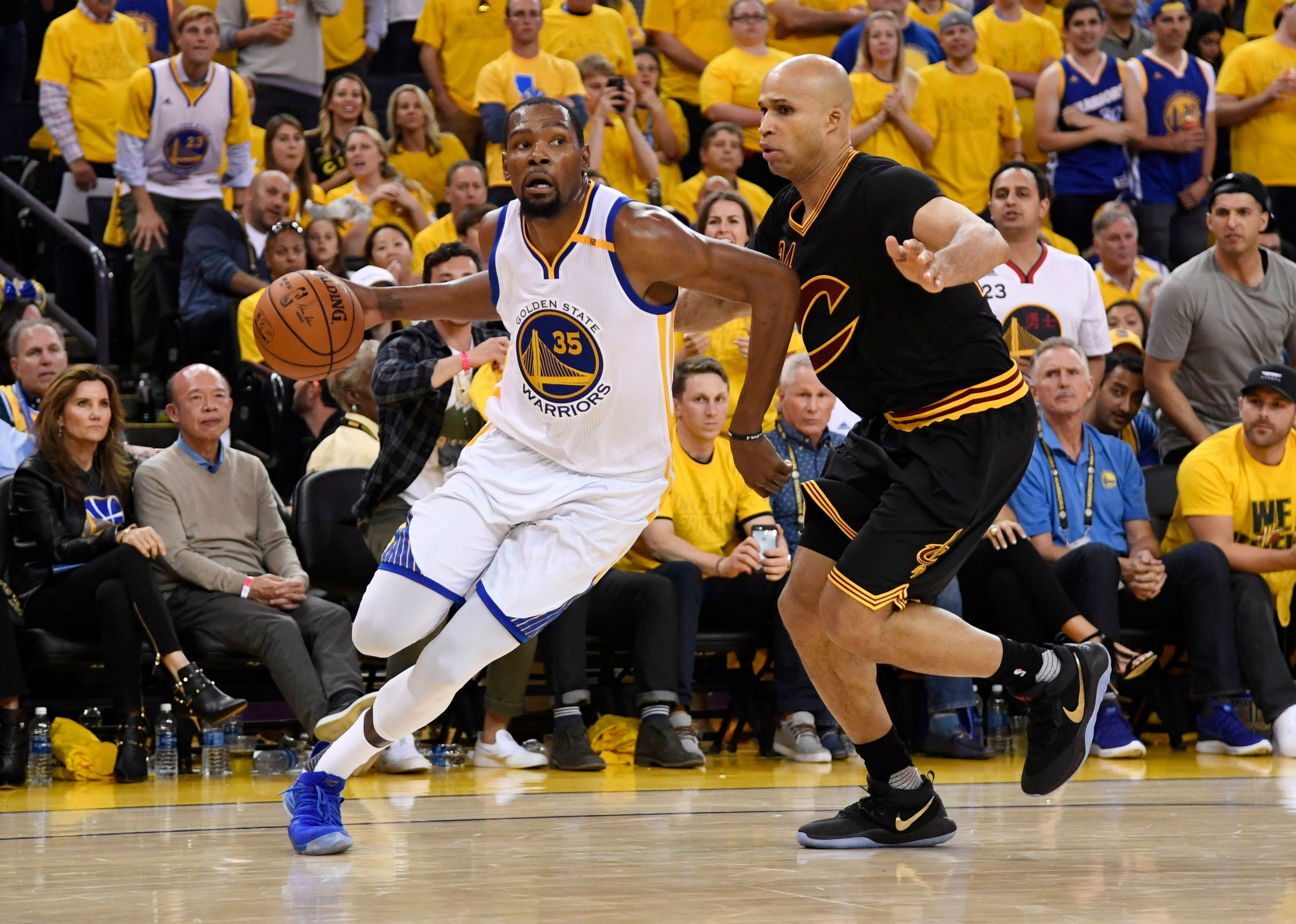 Jun 12, 2017; Oakland, CA, USA; Golden State Warriors forward Kevin Durant (35) drives past Cleveland Cavaliers forward Richard Jefferson (24) during the first half in game five of the 2017 NBA Finals at Oracle Arena. Mandatory Credit: Kyle Terada-USA TODAY Sports