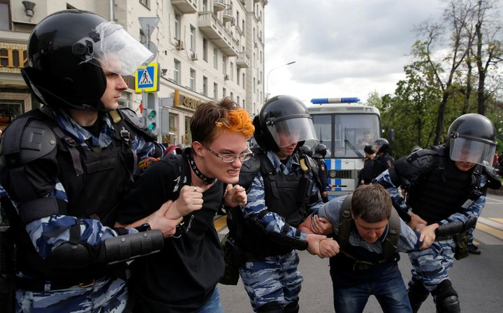 Police in riot gear arrest hundreds in cities across Russia on Monday during anti-Kremlin protests.