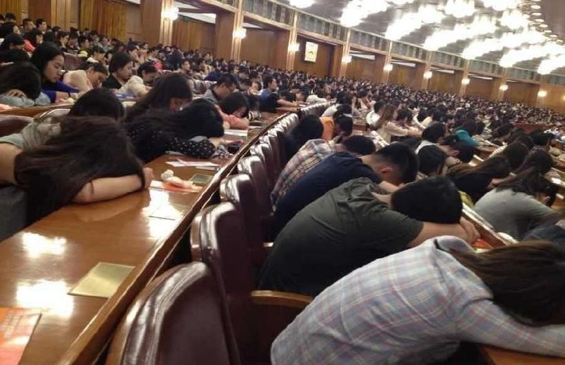 Students falling asleep during a lecture in Beijing.