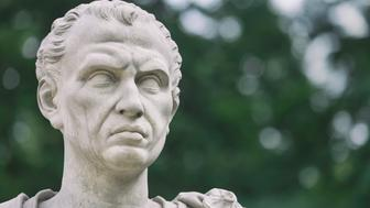 A sculpture of the roman emperor Julius Caesar near the old orangery in the public Lazienki Park, Warsaw. The sculpture was made by Franciszek Pinck (1733-1798).