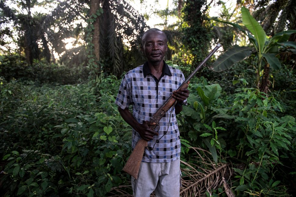 Jean-Marie Pongomoke poses with the gun he uses to hunt antelope outside his village of Salambongo in the Congolese bush.