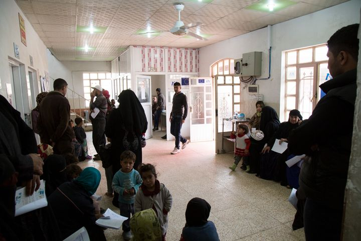 Patients wait to see a doctor at the primary health care clinic in Gogjali, a neighborhood in eastern Mosul. The area has bee