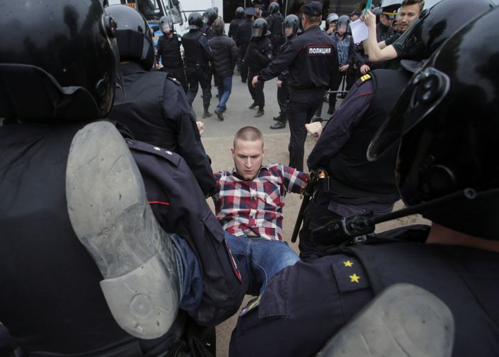 Riot police detain a demonstrator during an anti-corruption protest in central St. Petersburg, Russia, June 12, 2017.