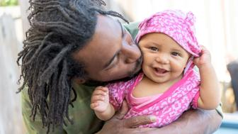 African american man posing posing holding his baby daughter