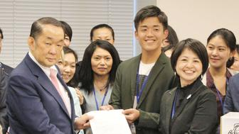 Representatives of civil groups urging reform of Japan's archaic sex crimes law hand Justice Minister Katsutoshi Kaneda (L) a petition in Tokyo, Japan, in this photo taken by Kyodo on June 7, 2017. Picture taken June 7, 2017.   Mandatory credit Kyodo/via REUTERS ATTENTION EDITORS - THIS IMAGE WAS PROVIDED BY A THIRD PARTY. EDITORIAL USE ONLY. MANDATORY CREDIT. JAPAN OUT. NO COMMERCIAL OR EDITORIAL SALES IN JAPAN.