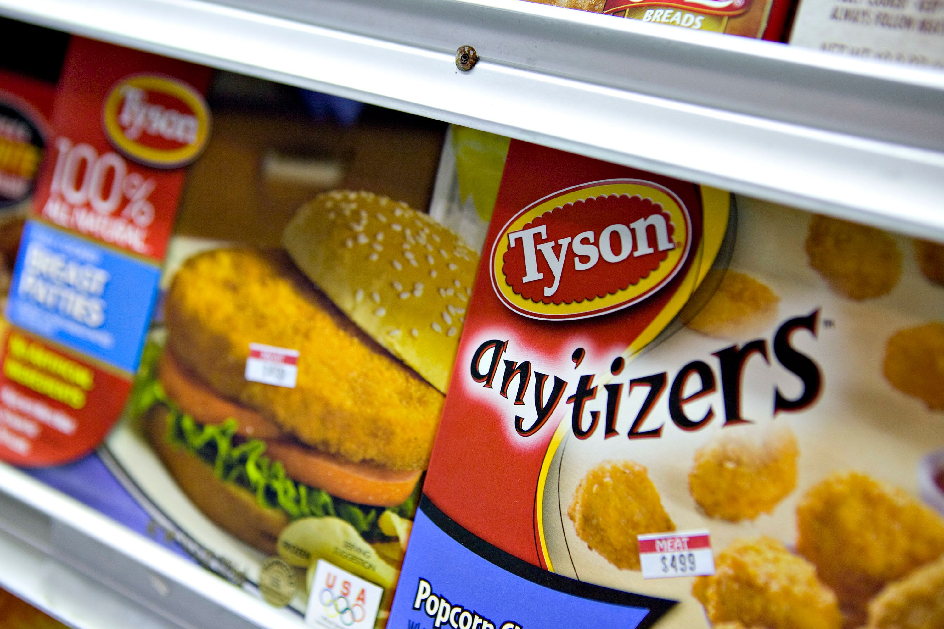 UNITED STATES - AUGUST 03:  Tyson popcorn chicken, right, and chicken patties sit on display in a supermarket in New York, U.S., on Monday, Aug. 3, 2009. Tyson Foods Inc., the world's largest meat producer, said profit climbed more than 10-fold in the third quarter as chicken prices increased.  (Photo by Daniel Acker/Bloomberg via Getty Images)