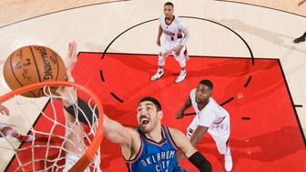 PORTLAND, OR - MARCH 2: Enes Kanter #11 of the Oklahoma City Thunder shoots a lay up during the game against the Portland Trail Blazers on March 2, 2017 at the Moda Center in Portland, Oregon. NOTE TO USER: User expressly acknowledges and agrees that, by downloading and or using this Photograph, user is consenting to the terms and conditions of the Getty Images License Agreement. Mandatory Copyright Notice: Copyright 2017 NBAE (Photo by Cameron Browne/NBAE via Getty Images)