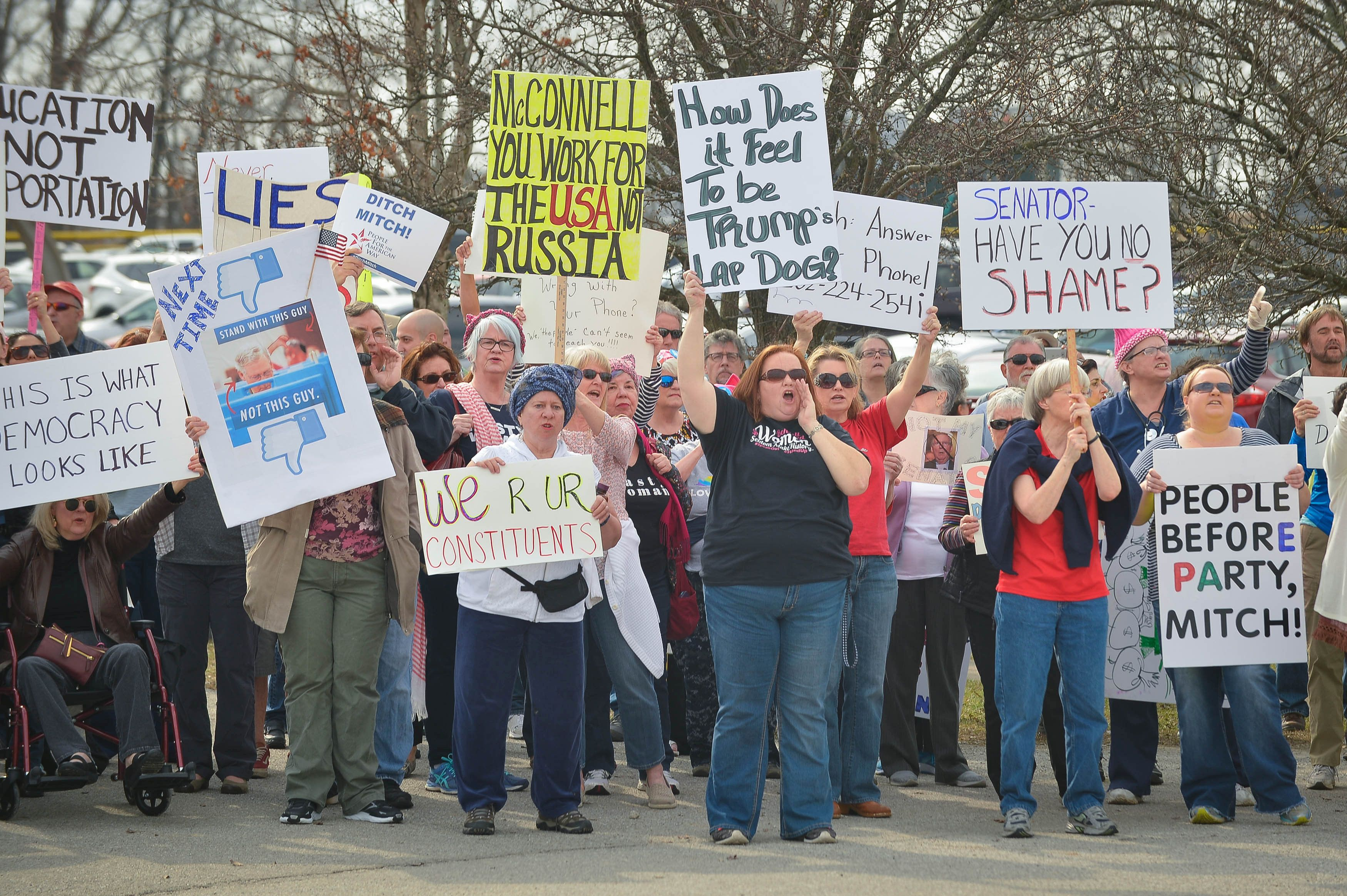 Protestors gather outside an event where U.S. Senate Majority Leader Mitch McConnell is scheduled to speak in Lawrenceburg, Kentucky, U.S., February 21, 2017.  REUTERS/Bryan Woolston