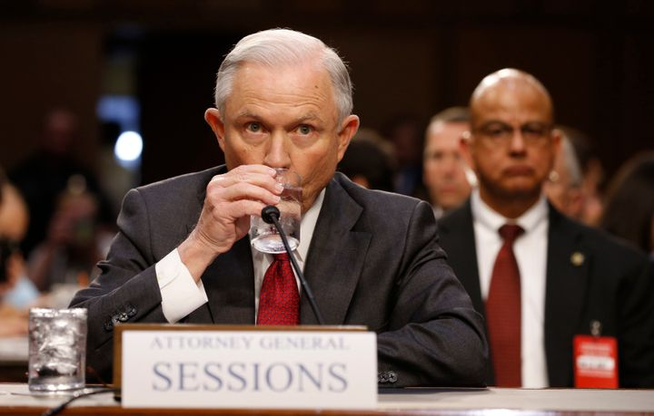 Attorney General Jeff Sessions takes a sip of water as he prepares to testify to a Senate committee Tuesday.