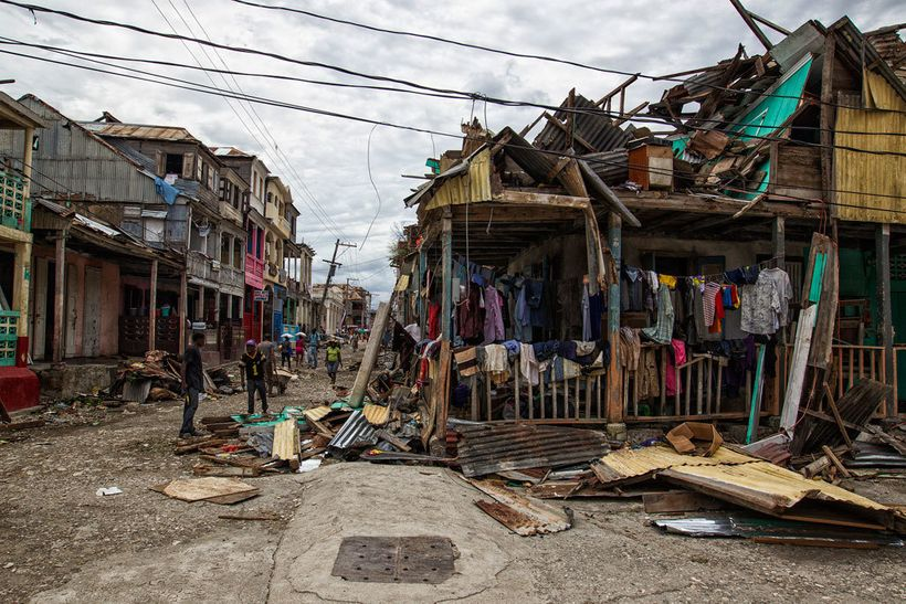 Local residents clean up streets in western Haiti in the wake of Hurricane Matthew which caused widespread damage in the Cari