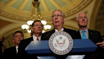 Senate Majority Leader Mitch McConnell, accompanied by Sen. Cory Gardner (R-CO), Sen. John Barrasso (R-WY) and Sen. John Cornyn (R-TX), speaks to the media following the weekly policy luncheons on Capitol Hill in Washington, D.C., U.S., June 6, 2017. REUTERS/Aaron P. Bernstein