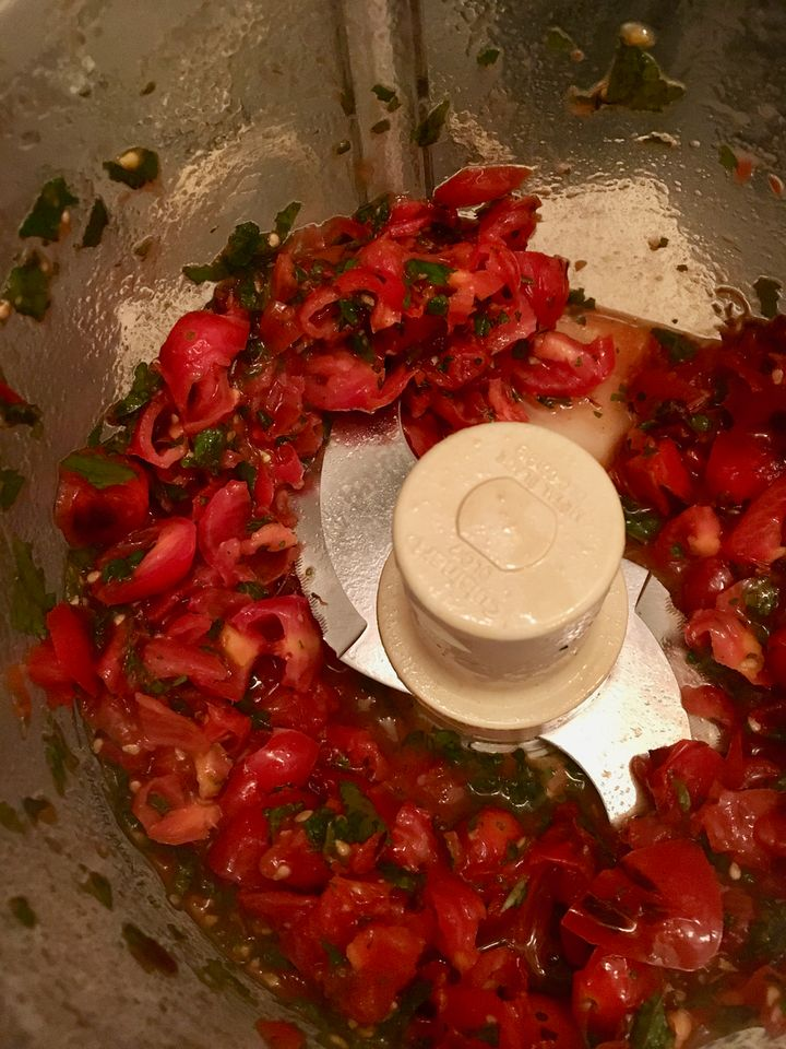 Rough-chop the tomatoes with the previously chopped mint