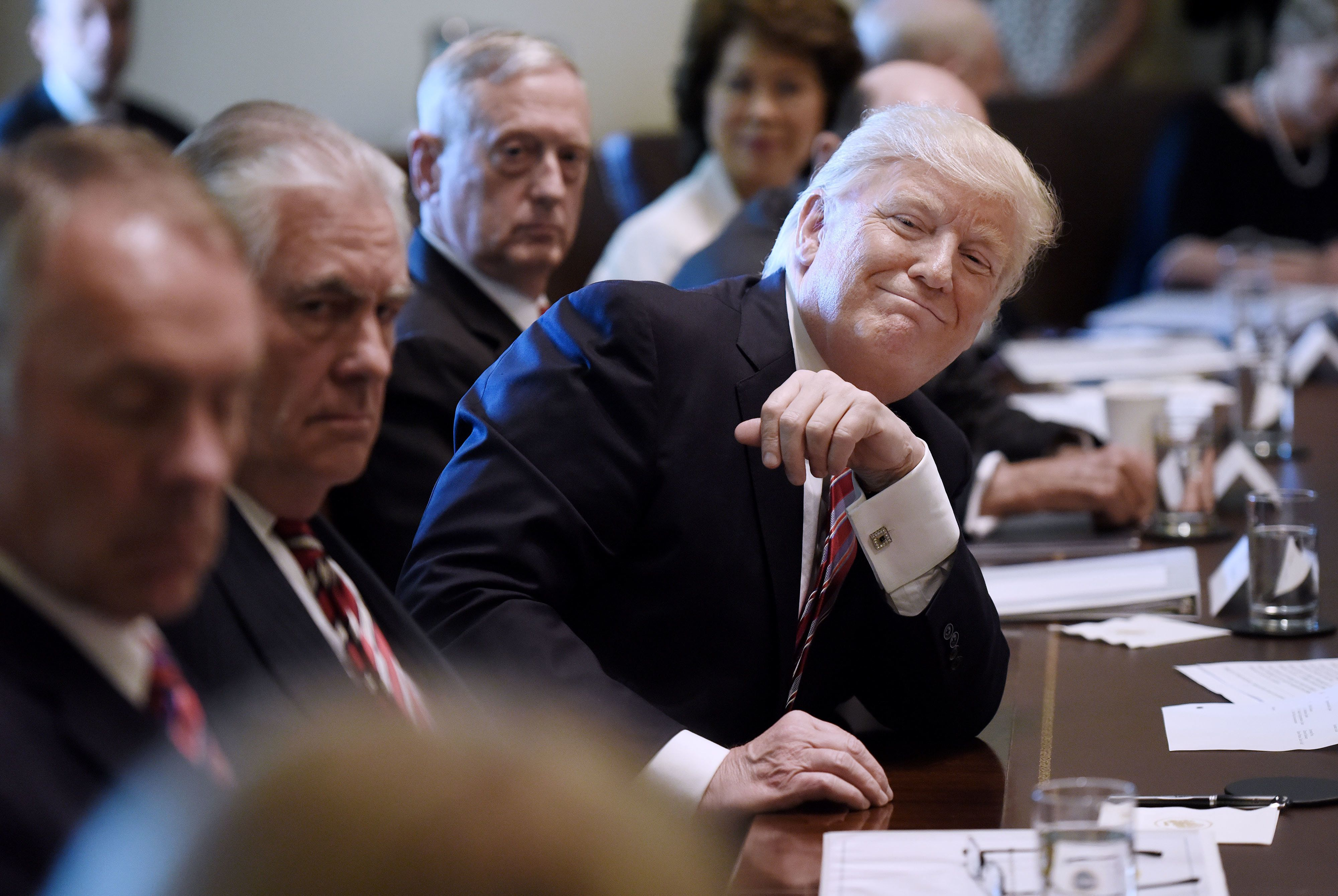 U.S. President Donald Trump smiles during a meeting with Cabinet members at the White House in Washington, D.C., U.S., on Monday, June 12, 2017. U.S. Attorney GeneralJeff Sessionswill testify publicly Tuesday before the Senate Intelligence Committee, a high-stakes event that comes days after fired FBI DirectorJames Comey'sdramatic appearance. Photographer: Olivier Douliery/Pool via Bloomberg