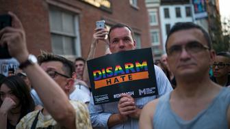 NEW YORK, NY - JUNE 12:  People observe a moment of silence after victims names' were read during a memorial service and rally for the victims of the 2016 Pulse nightclub shooting, down the street from the historic Stonewall Inn June 12, 2017 in New York City. Monday marks the one year anniversary of the Pulse nightclub shooting in Orlando, Florida that killed 49 people. (Photo by Drew Angerer/Getty Images)
