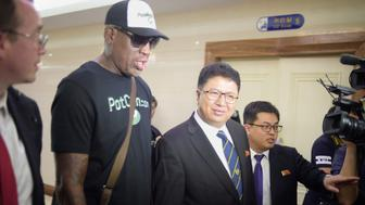 Flamboyant former NBA star Dennis Rodman (2nd L) of the US talks with Son Gwang-Ho (C), North Korea's vice minister for sports and culture, after his arrival at Pyongyang International Airport on June 13, 2017. Rodman arrived in North Korea on June 13 after saying he wants to 'open the door' to the regime and claiming that US President Donald Trump would be pleased with his mission. / AFP PHOTO / Kim Won-Jin        (Photo credit should read KIM WON-JIN/AFP/Getty Images)