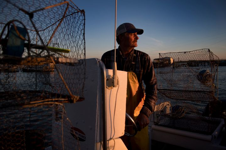 Mayor and waterman James Eskridge sets out to check his crab traps during the early morning in Tangier, Virginia, May 16, 201
