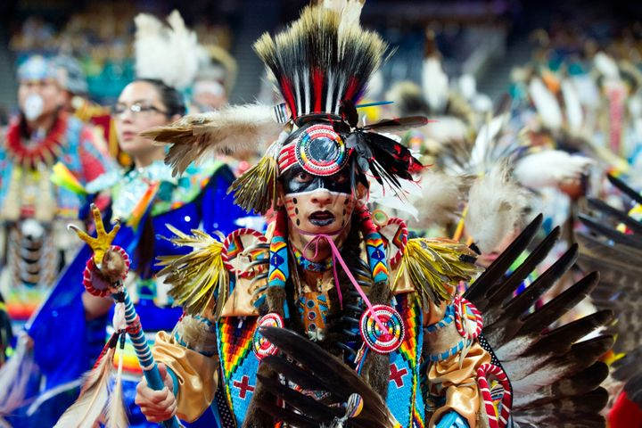 Ziggy Williams of the Navajo Nation dances during the Grand Entry of the Denver March Powwow on March 24 in Denver, Colorado.
