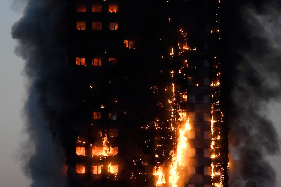 Flames and smoke billow as firefighters deal with a serious fire in an apartment building in west London.