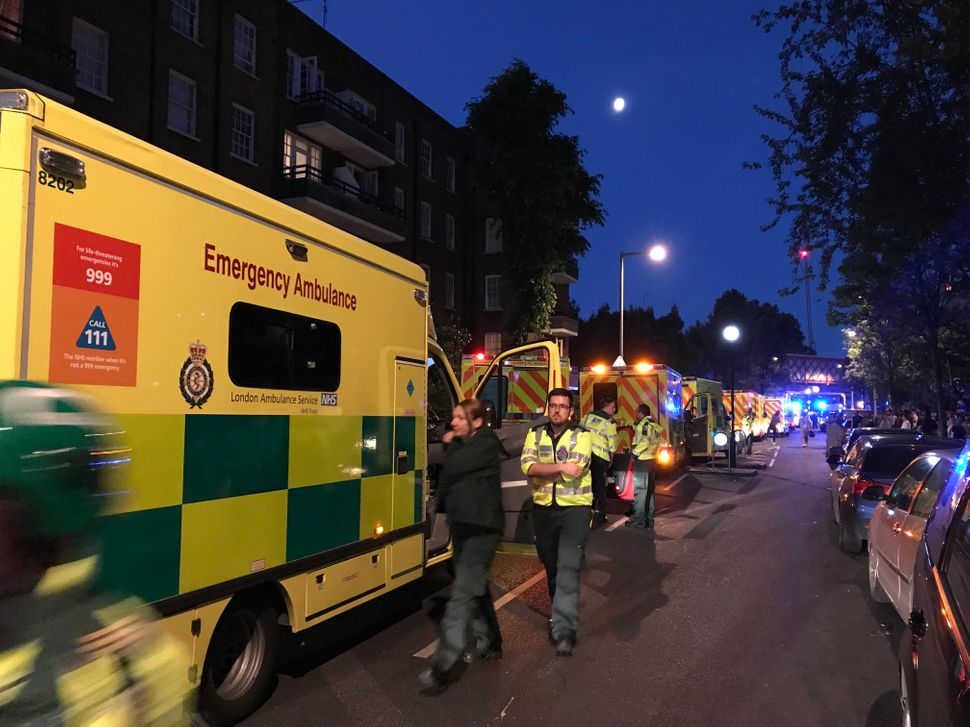 Emergency services respond tothe fire. Twenty ambulance crews and 200 firefighters were on the scene.