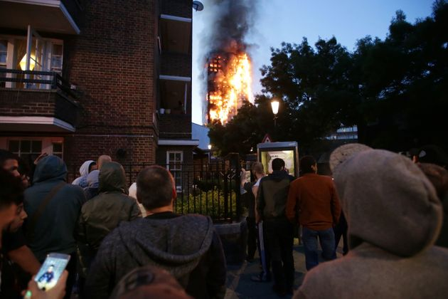 Residents watch as the27-storey Grenfell Tower burn where a 'number of fatalities' have