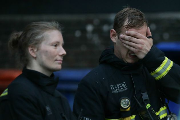 Fire fighters react to the blaze which has been described as