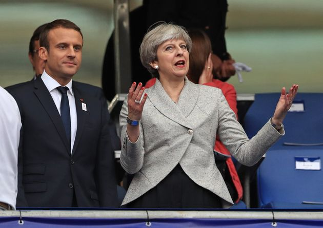 French President Emmanuel Macron (left) and Theresa