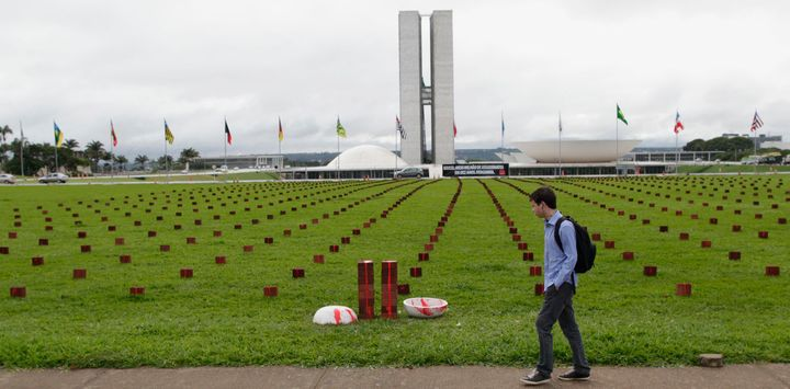 Bricks, laid out in front of Congress, represent the staggering number of Brazilians killed each week.
