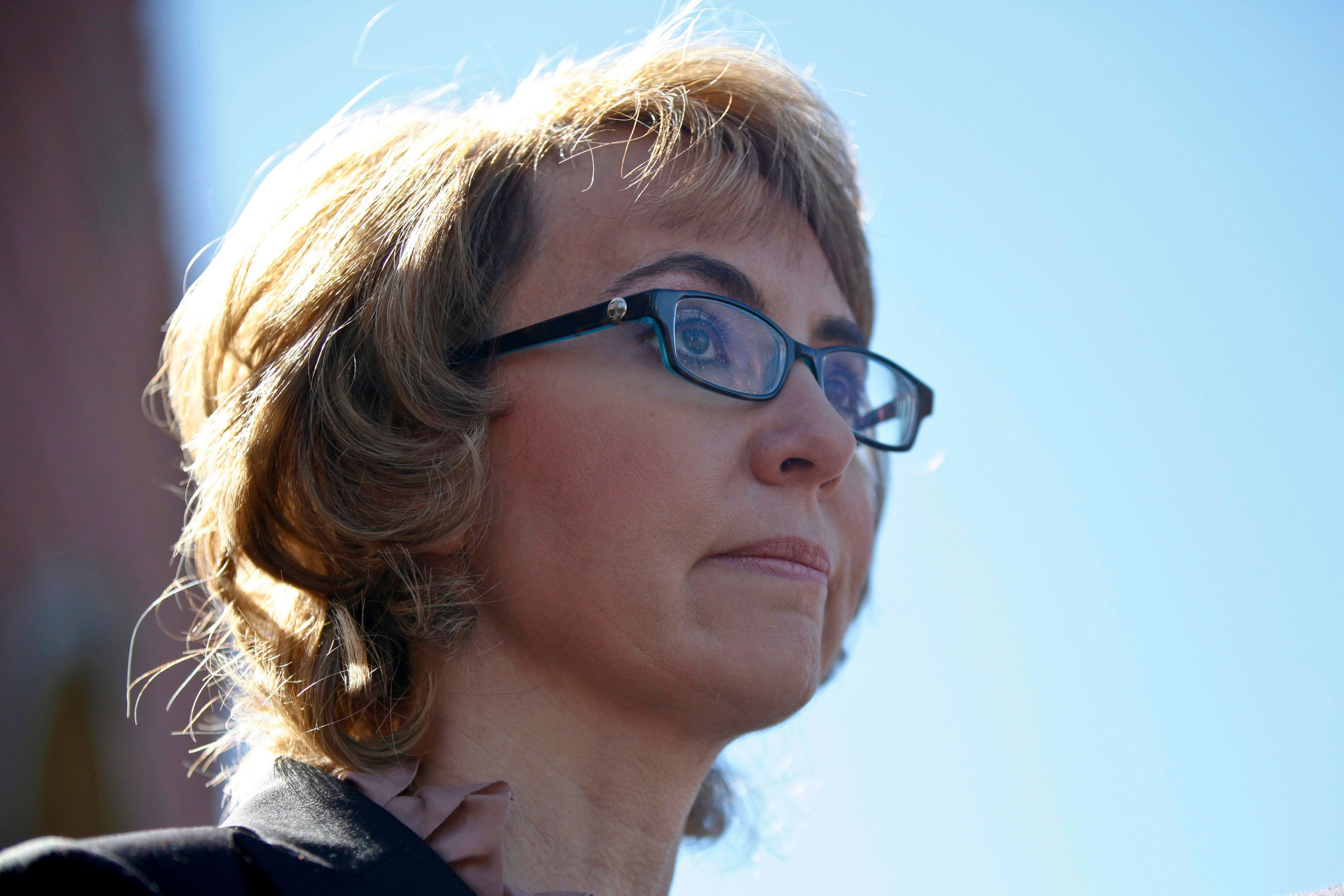 Former congresswoman Gabrielle Giffords addresses a news conference for victims of the January 8, 2011 Tucson shooting, at the Safeway grocery store parking lot where Giffords was shot during the incident in Tucson March 6, 2013. The news conference was held to urge action on common sense solutions to reduce gun violence, including universal background checks, which will be taken up by the Senate Judiciary Committee later this week. REUTERS/Samantha Sais (UNITED STATES - Tags: CRIME LAW POLITICS PROFILE)
