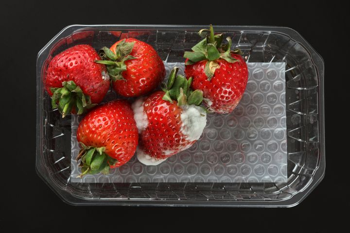 A box of moldy strawberries you probably don't want to eat.