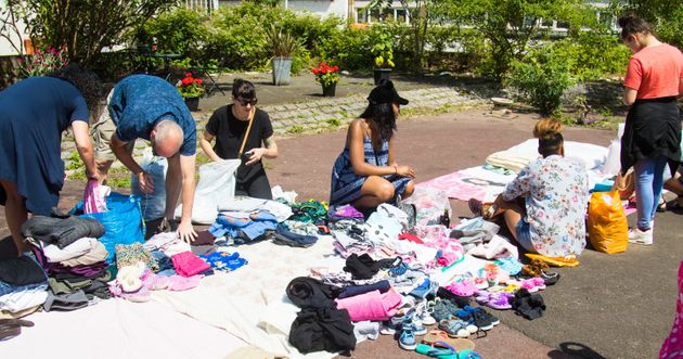 Volunteers categorise clothing donations by kind and