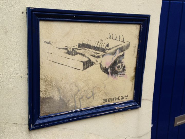 An early Banksy stencil in his home city of Bristol.