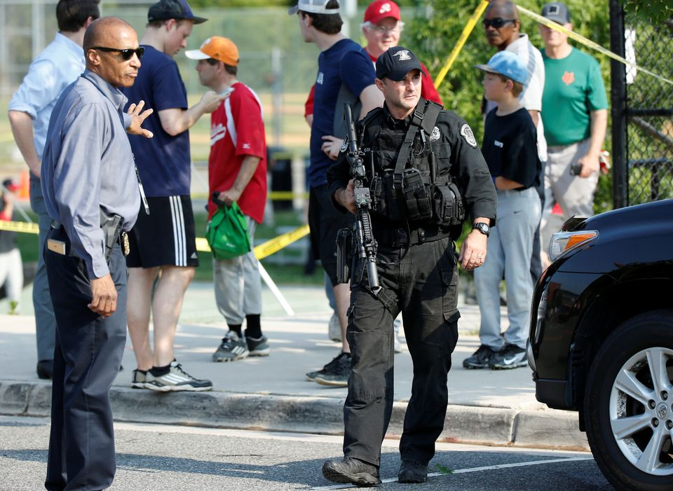 Police investigate a shooting scene after a gunman opened fire on Republican members of Congress during a baseball practice n