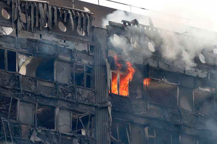 Flames and smoke continue to engulf Grenfell Tower in London on Wednesday.