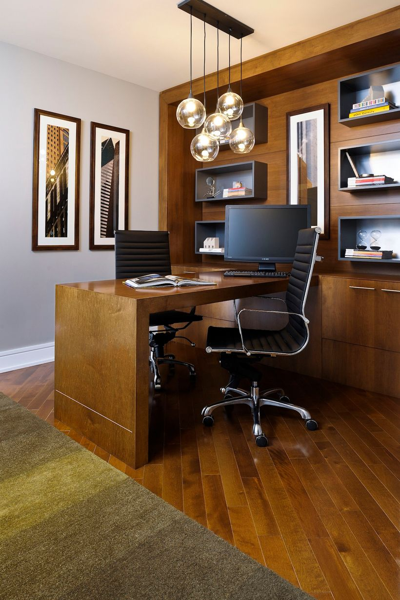 Wasted circulation space in an oversized bedroom was reconfigured to become a home office, turning the unit into a one-bedroo