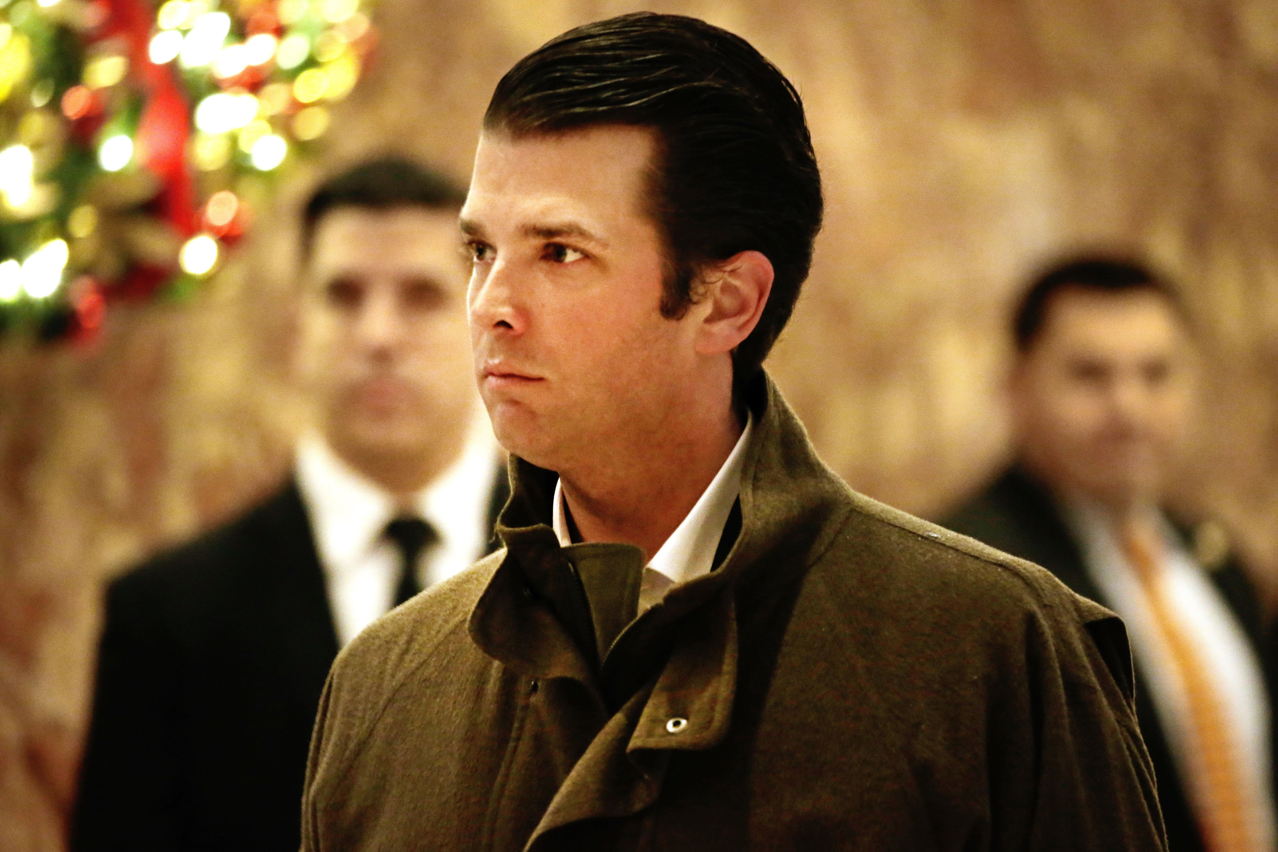 Donald Trump Jr., son of U.S. President-elect Donal Trump, walks through the lobby of Trump Tower in New York, U.S., on Monday, Jan. 2, 2017. President-elect Donald Trump won't end the onslaught of posts on Twitter that fed his unconventional campaign, even after taking on the formalized duties of the Oval Office later this month. Bloomberg: Peter Foley/Pool via Bloomberg