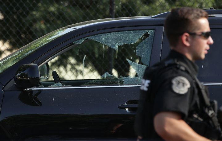 A broken window on a vehicle is seen outside Eugene Simpson Stadium Park, where the shooting took place.