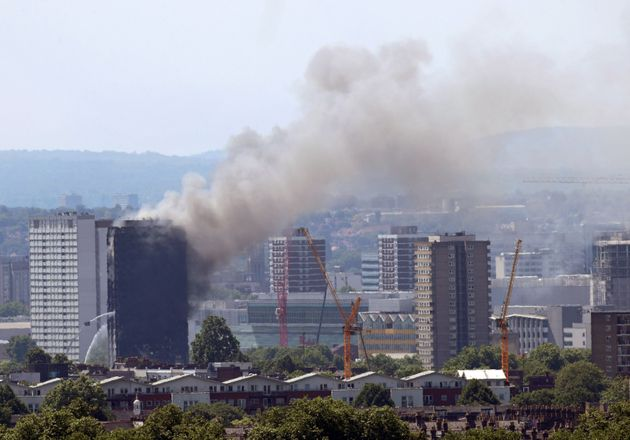 Grenfell Tower continues to smoke on Wednesday