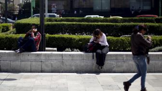 People use their cell phones in Mexico City, October 8, 2015. Government surveillance requests are gathering pace in Mexico, raising concerns about lack of oversight in a country plagued by corruption and collusion between security forces and criminal gangs. Last year, Mexican mobile operators fielded more than 55,000 requests from authorities for information on citizens' calls, messages, and location data, nearly 25 percent higher than in 2013, according to industry figures obtained by Reuters. Picture taken October 8, 2015. REUTERS/Edgard Garrido