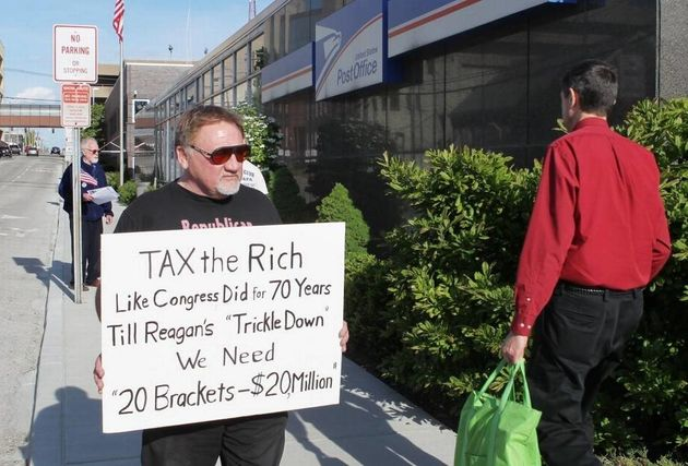 James Hodgkinson protests outside the United States Post Office in downtown Belleville,