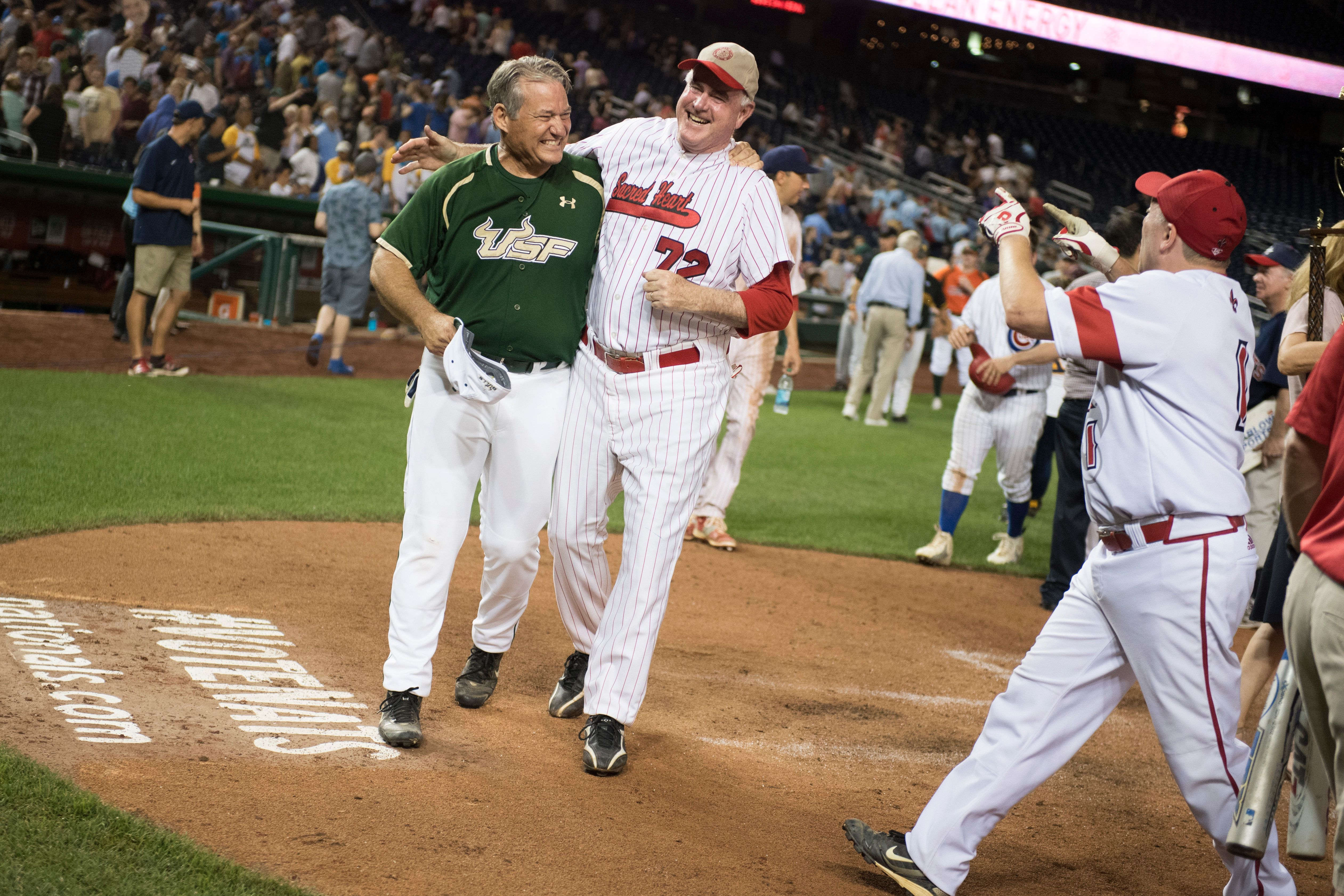 UNITED STATES - JUNE 23: From left, Reps. Dennis Ross, R-Fla., Patrick Meehan, R-Pa., and House Majority Whip Steve Scalise, R-La., celebrate after the Republicans' 8-7 victory in the 55th Congressional Baseball Game in Nationals Park, June 23, 2016. (Photo By Tom Williams/CQ Roll Call)