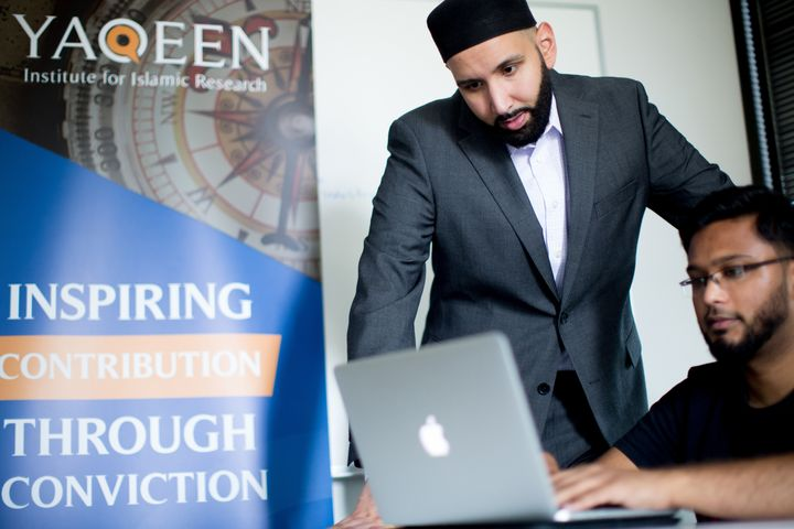 Imam Omar Suleiman and Ali Fiaz, the operations manager at Yaqeen Institute, at work in Las Colinas, Texas.