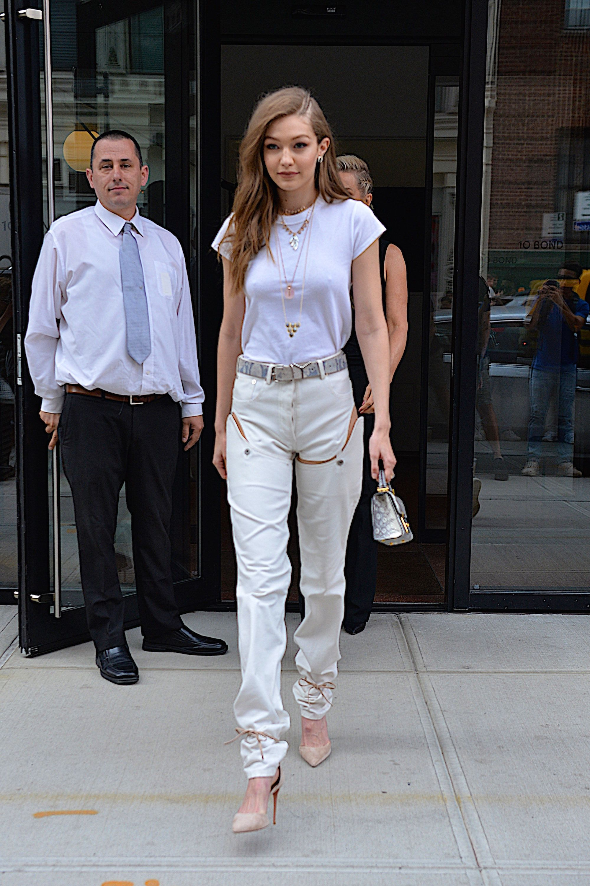 """Hadid wearing<a href=""""https://www.openingceremony.com/womens/y_project/washed-cut-out-detachable-short-jeans-ST96198.ht"""